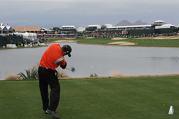 Scenes From the FBR Open                       Sports Illustrated's Fred Vuich and Robert Beck were at TPC Scottsdale to shoot the FBR Open. Here are their favorite images from the tournament.                       J.B. Holmes was a shot behind Phil Mickelson heading into the par-4 18th on Sunday at the FBR Open. He ignored the water and bunkers and ripped his tee shot over the corporate tents on the left side.