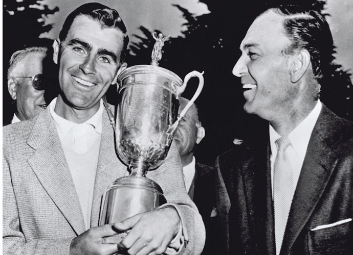 "Jack Fleck (left) and Ben Hogan, runner-up, gather during the trophy presentation after Fleck won the 1955 U.S. Open Championship at the Olympic Club in San Francisco, Calif.  The original caption with the photo read: ""Love That Lovin' Cup - Jack Fleck, unknown young pro from Davenport, Iowa, cuddles the trophy emblematic of the U.S. Open golf championship after beating Ben Hogan, right, by three strokes in an 18-hole playoff here today. Never showing a trace of nervousness, Fleck carved out a one-under-par 69 to become the darkest dark horse to win the championship since Sam Parks did it 20 years ago at Oakmont, Pa."""