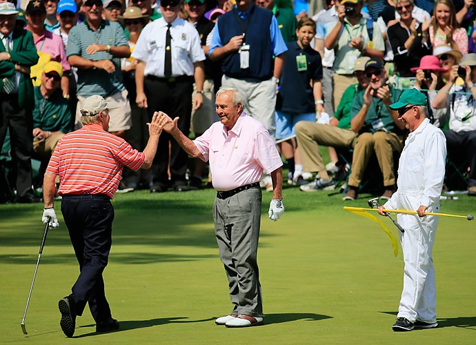 Jack Nicklaus and Arnold Palmer exchange high-fives.