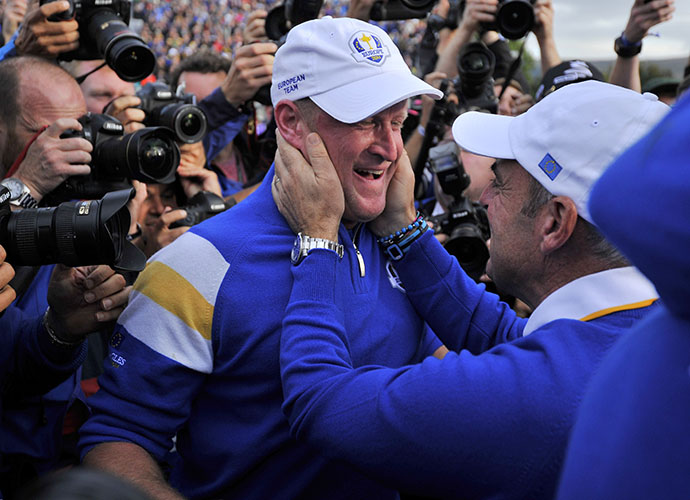 Captain Paul McGinley congratulates Jamie Donaldson on his win.