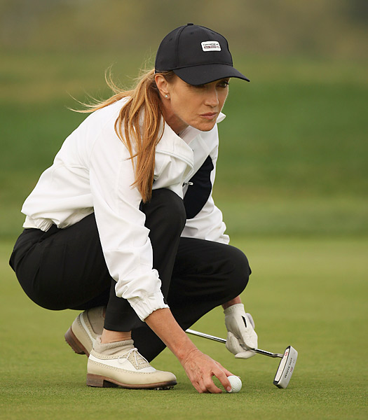 Jane Seymour lines up a putt during the pro-am event prior to the 2008 Commercial Bank Qatar Masters.