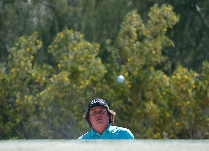 Jason Dufner calmly advanced with a 2 and 1 win over Italy's Matteo Manassero.