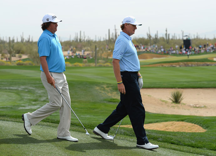 Jason Dufner and Ernie Els head to the tee during their match. Els prevailed, 1 up.