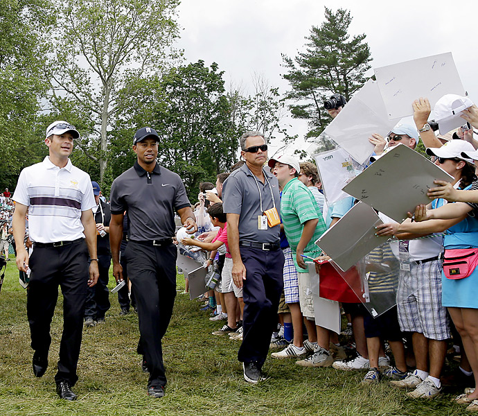 Woods played a few holes with mini-Tour qualifier Jesse Smith Tuesday.