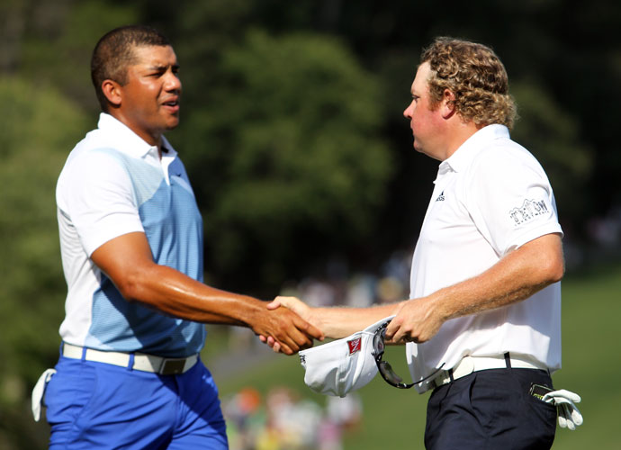 JJhonattan Vegas shakes hands with William McGirt at the end of the third round. Vegas (-9) is five shots back and McGirt (-7) is seven back.