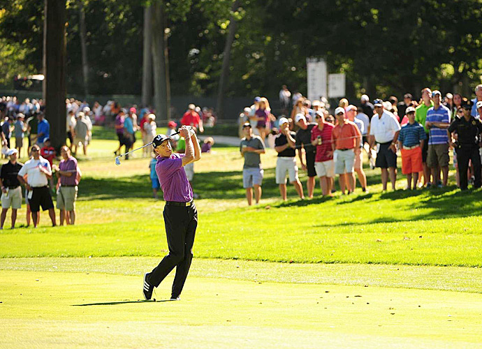 Jim Furyk fired a two-under 68 on a tough day at Oak Hill to take the lead.