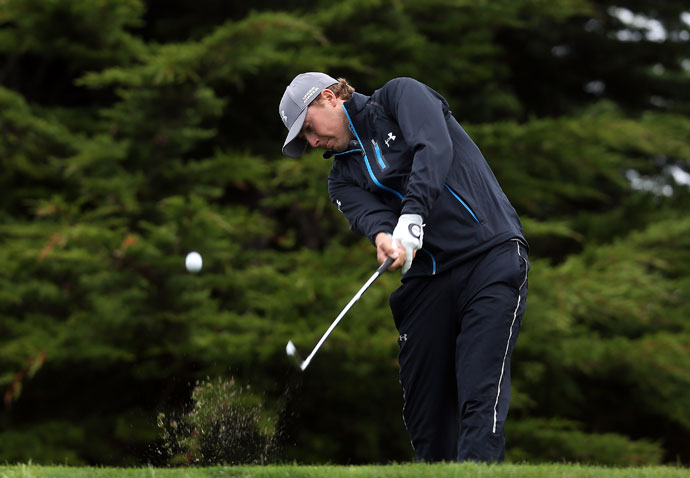 Jordan Spieth hits a tee shot on the 11th hole at Monterey Peninsula Country Club in the second round. Spieth shot his second consecutive 67, good for a tie for first with Jimmy Walker.
