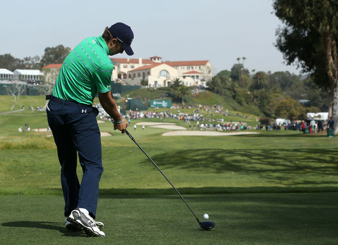 Jordan Spieth hits a tee shot on the ninth hole in the third round of the Northern Trust Open at Riviera Country Club. Spieth shot 67 and was -8, four shots back of leader William McGirt.