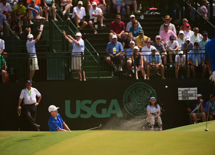 """Jordan Spieth hits from a greenside bunker during his opening-round 69. """"The trickiest thing is to figure out where that spot is you can miss to certain pins,"""" Spieth said. """"I feel like I could improve on the way I struck the ball and putting. But scoring-wise I'd take it again."""""""