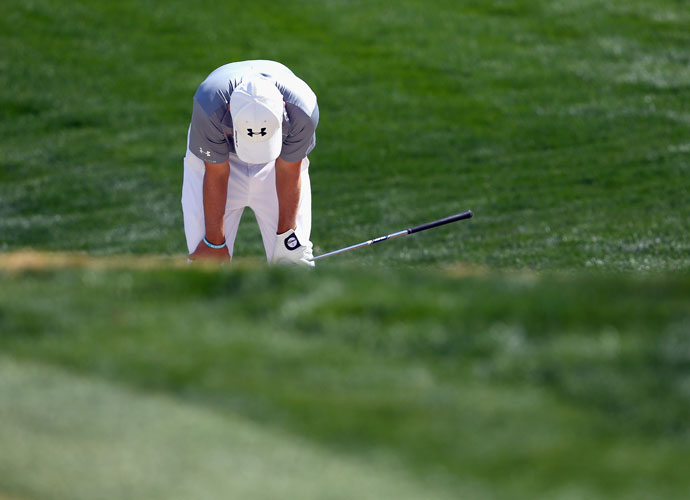 """Jordan Spieth reacts after hitting a poor third shot on the second hole during his match against Ernie Els. After the round, Spieth tweeted: """"I'm embarrassed about the way I acted on the course today.. Played like the 13 year old version of myself mentally. A lot of positives...From the last three weeks and ready to come back strong at Doral! Everybody has tough days and I'll handle it better next time for sure."""""""