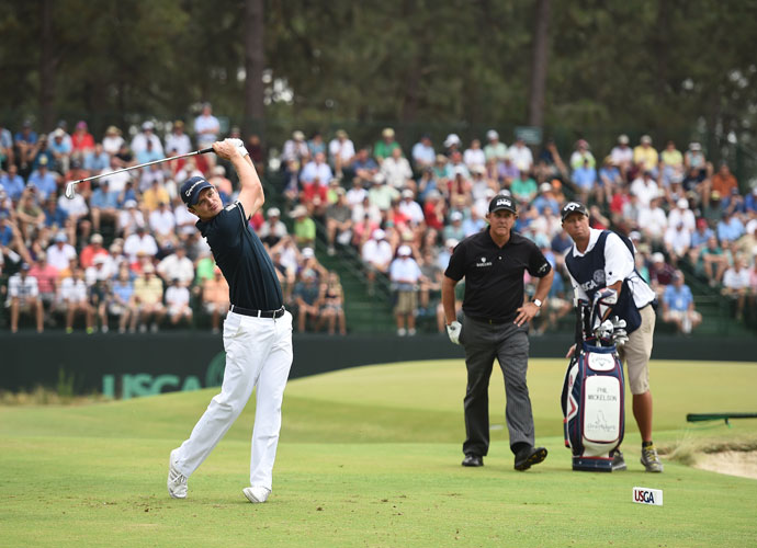 Justin Rose hits a tee shot during his opening round. The defending champion finished with a 2-over 72.