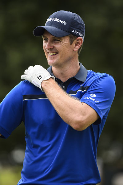 Justin Rose cracks a smile on the practice range ahead of Saturday's third round. Rose fired his second-straight 66 to join the group in fourth at 6 under.