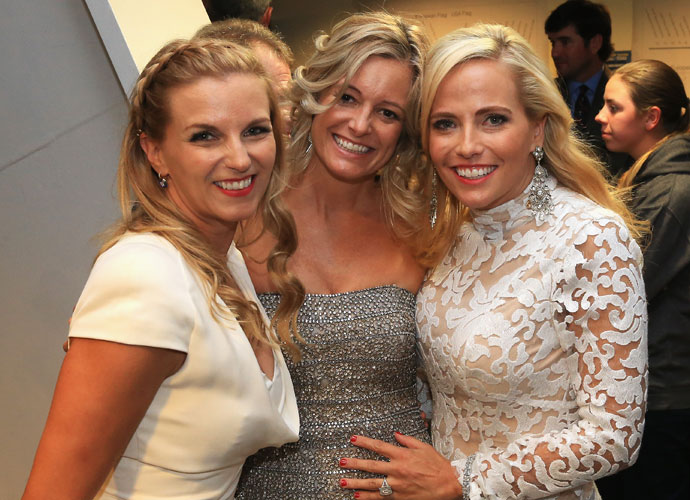 Kate Rose, wife of Justin Rose, joins Tabitha Furyk and Amy Mickelson at the gala.
