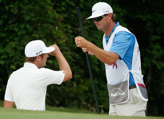 Kevin Chappell shot 29 on the front nine on the way to his third-round 63, the low round of the day. He entered the final round at 6-under, a shot behind the leaders. He gets some kudos from his caddie after making an eagle on the 11th hole.