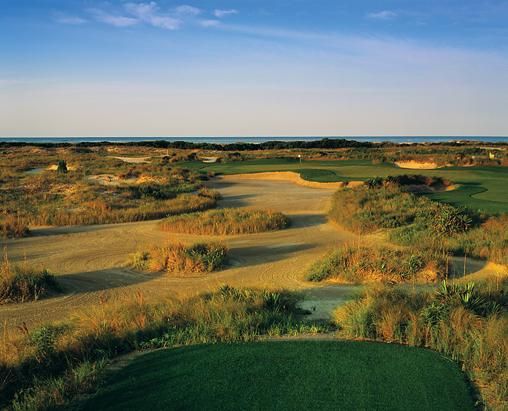 Hole 5, 188 yards, Par 3                       The first par-3 on the Ocean Course features its largest green: a roughly 10,000-square-foot hourglass that runs diagonally away from the tee. The waste-area short and left affords it some protection, but there's plenty of room to bail out right.