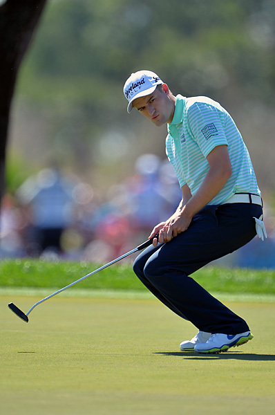 Scotland's Russell Knox, the only player among the top eight without a PGA Tour win, uses some body language to direct a putt. He shot a 68 to climb into third place.