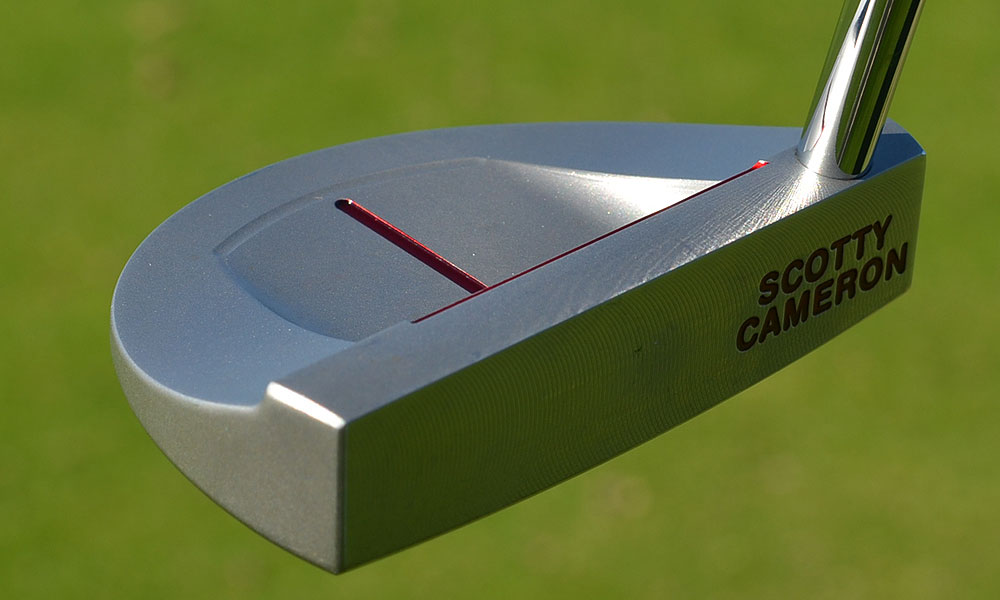 Kyle Thompson's Scotty Cameron for Titleist Select GoLo putter had its black finish sanded off, allowing the stainless steel to shine in the sun.