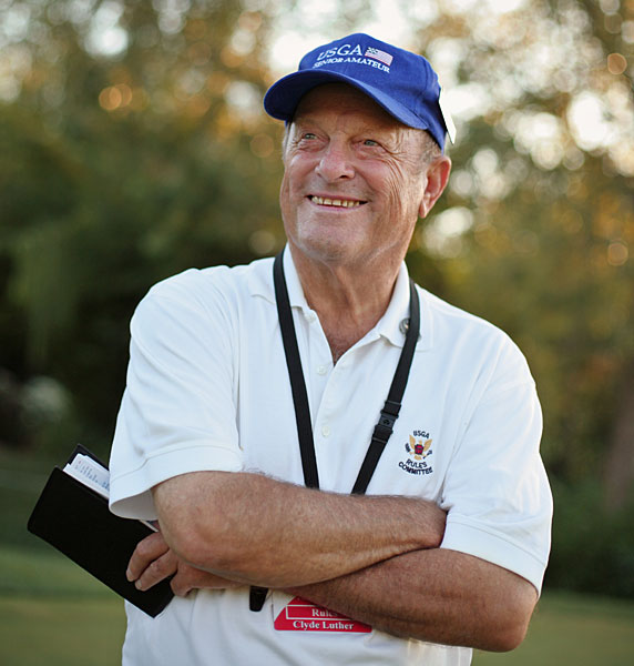 "The Vocal Volunteer                     CLYDE LUTHER, 78                     Teaching Tiger wannabes how to play by the Rules                                                               ""I've been a volunteer Rules marshal for almost 40 years. Let's see, that's 111 USGA championships, one Masters, 20 U.S. Opens, who knows how many junior                     events. An innovator? I don't know. Some people say there wouldn't be a Junior Amateur if it wasn't for people like me. That's flattering. I think everyone should do more to help golf. I do it because I love the game, and enjoy educating young people. After all, life is all about the people you meet. Tiger is a friend. Known him since he was 12. In a tournament, he'll walk right by everyone else, then see me and give me a big hug. That means a lot. He has a great sense of humor. At the '98 U.S. Open at Congressional, he almost shanked one into the rough, then walks by me and says, 'Clyde, I don't know why I play this stupid                     game. I oughta take up stamp collecting.' I've taught a lot of kids about etiquette and the Rules. I remember this 12-year-old. I saw him pick up his ball in the fairway and drop it. I came over to ask why he dropped — I figured he had an issue with a sprinkler head. He says, 'No, it wasn't that. My ball was in a divot. I don't have to hit it from there, do I?'""                                                               Help us choose the 2008 Innovators!                                                                                    Update: The latest from Clyde Luther"