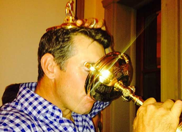 Lee Westwood takes a sip of glory.