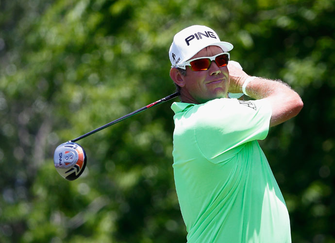 Lee Westwood watches his tee shot on the fifth hole. He shot a 1-under 71 and was -6 after two rounds.