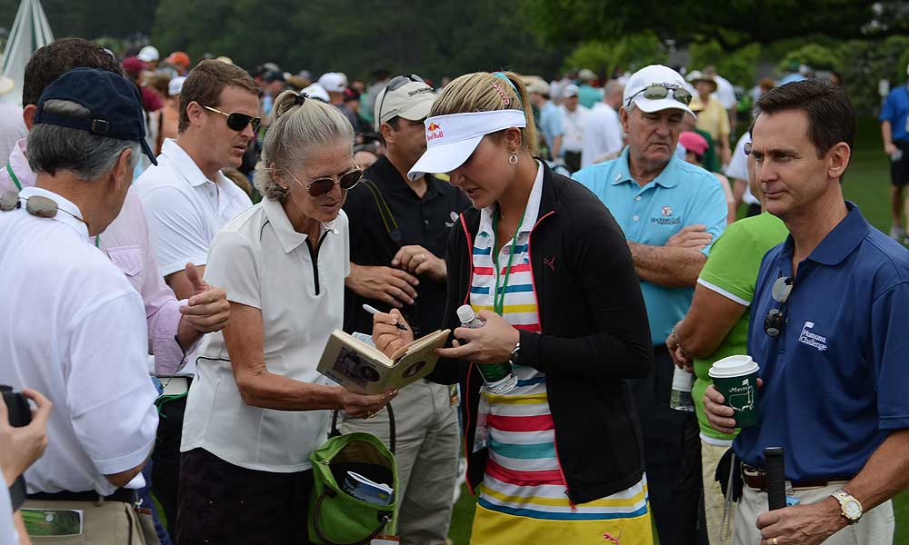 LPGA star Lexi Thompson drew a lot of attention when she walked past the practice green.