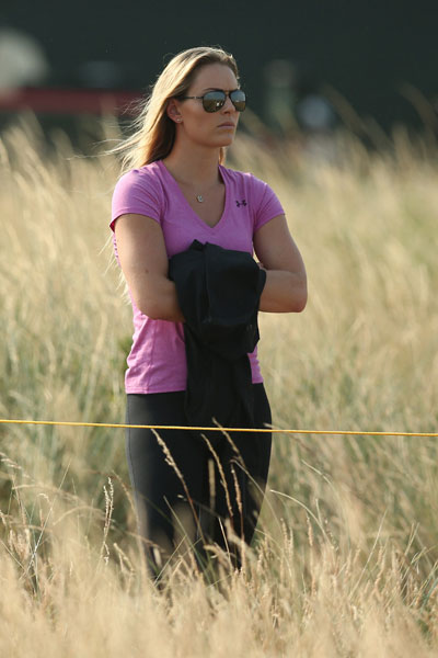 Olympic skiier Lindsey Vonn watches the play of boyfriend Tiger Woods during the second round.