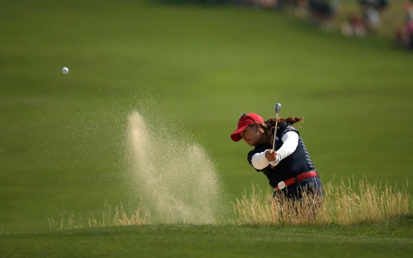 Lizette Salas of United States hits from a bunker on the 16th hole.