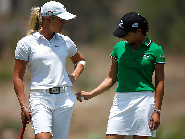 Ochoa with one of her main rivals, Norway's Suzann Pettersen, during the final round of the 2009 LPGA Corona Morelia Championship in Mexico. Ochoa went on to win the event.
