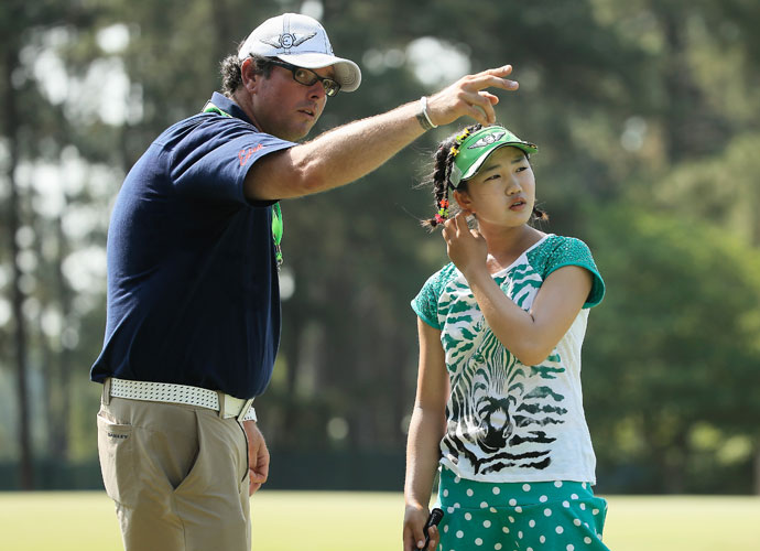 Lucy Li chats with caddie Bryan Bush during a practice round prior to the start of the 69th U.S. Women's Open at Pinehurst.