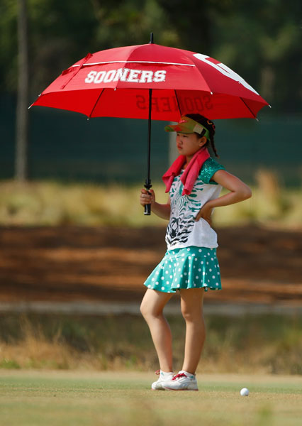 Lucy Li keeps cool during a practice round Tuesday at Pinehurst No. 2.