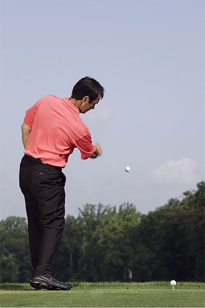 Attack on the proper angle                                              THE GOAL For maximum distance, the driver must approach the ball on a shallow angle of attack that slightly ascends through impact.                                              THE DRILL Stand at address with a ball in your right hand. Take that hand up to the top and then bring it down toward impact, but at the bottom of your swing release the ball underhanded toward the target to promote a shallower release.