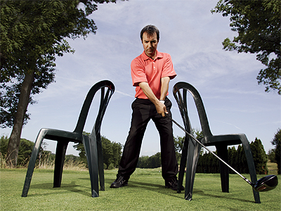 Control your clubface                                              THE GOAL Even if you've gotten torque, width, and the angle of attack correct, if the clubface isn't square to the ball and low to the ground as it passes through impact, you won't be able to get the distance and accuracy that you're looking for.                                              THE DRILL Place a chair outside each foot and swing your driver so that it goes no farther back or forward than the outside of either chair. This will teach you how to square the clubface and keep the clubhead on a low but slightly upward path into impact.