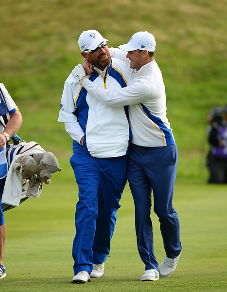 Martin Kaymer (left) celebrates his halve in foursomes.