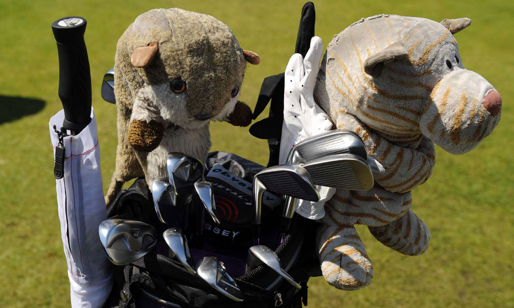Martin Kaymer's classic TaylorMade rac TP blade irons are watched over by equally venerable tiger and squirrel headcovers.