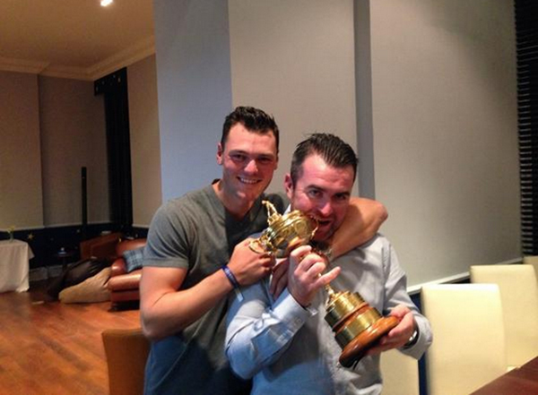 Martin Kaymer hams it up with the Samuel Ryder trophy.