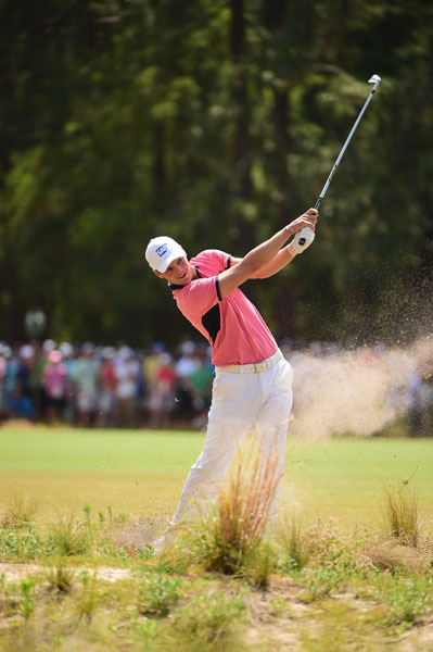 Martin Kaymer blasts from the pine straw during his third round. He birdied No. 18 to finish -8, good for a five-shot lead over Rickie Fowler and Erik Compton.