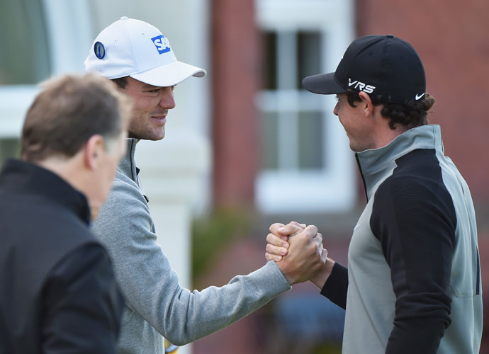 U.S. Open champion Martin Kaymer greets Rory McIlroy before the start of their practice rounds at Royal Liverpool on Tuesday.