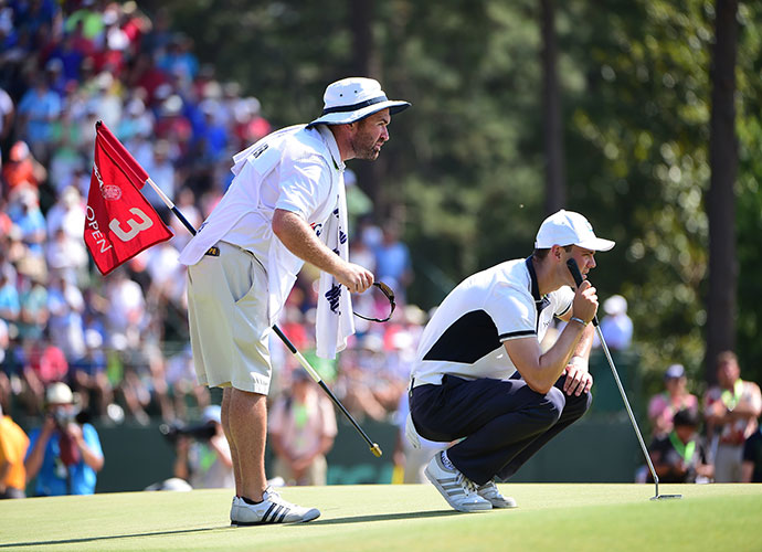 Kaymer and his caddie Craig Connolly line up a putt.