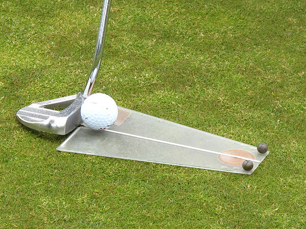 warmed up his putting stroke Thursday by using a vintage Dave Pelz Putting Tutor. By hitting putts along the line on the plastic board, without hitting either of the two marbles, Kuchar knows he is starting each putt on target.