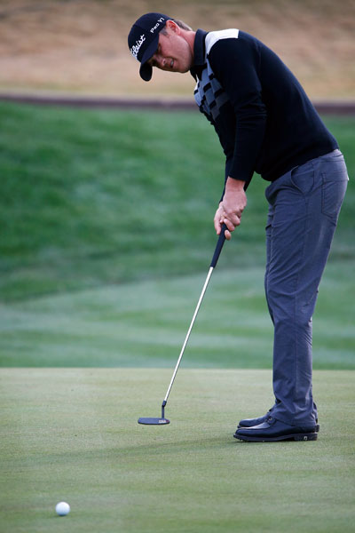 Matt Jones putts on the seventh hole during the second round of the Waste Management Phoenix Open.