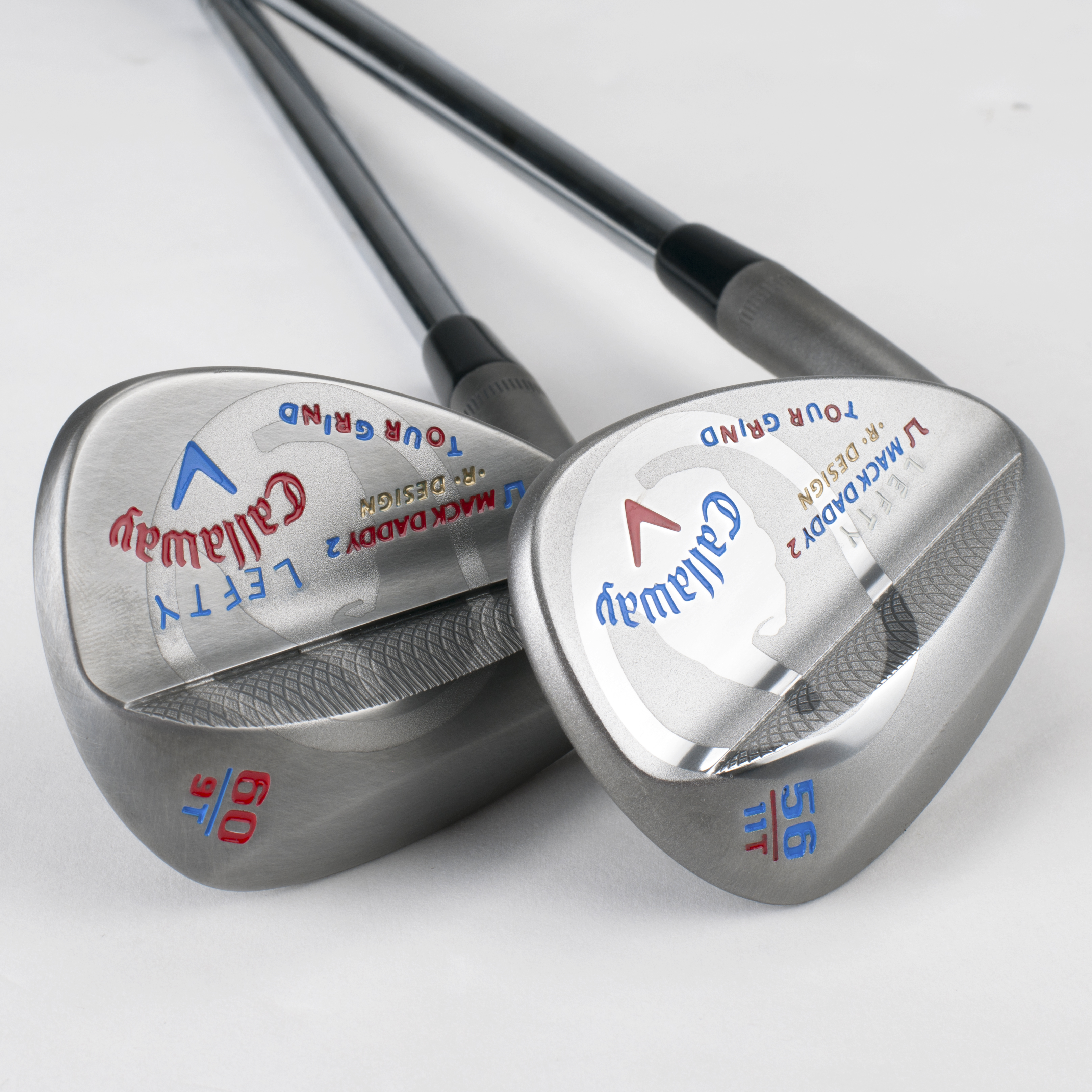 Callaway Mack Daddy 2 wedges made for Phil Mickelson commemorate his 2013 British Open victory. Notice the thumbs up. The wedges Phil uses in competition are not stamped.