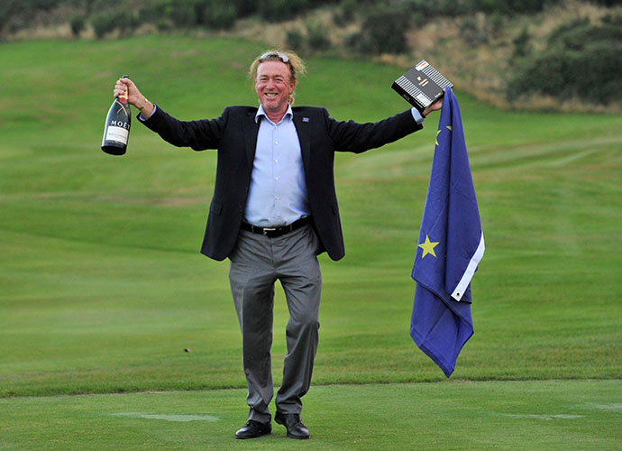 Miguel Angel Jimenez celebrates in style, a bottle of champagne and box of cigars on hand.