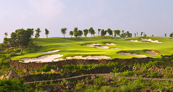 Mission Hills Resort Haikou, Haikou, Hainan Island, China                       One of Asia's foremost tournament tracks is the centerpiece of the new Mission Hills complex in southern China that has 10 courses and counting. Amid the surplus of new layouts, there's no chance of this beautiful brute getting lost in the crowd. Following a host of celebrity designers who were enlisted to help out at the first mammoth Mission Hills site, located in Shenzhen on the mainland, Chinese golf patriarch Dr. David Chu let designer Brian Curley go it alone on Hainan, and he went on to carve out a relentless lineup of heavily bunkered holes draped on black volcanic rock, a striking if unplayable hazard that frames many fairways. At 7,808 yards and par-73, the aptly named Blackstone course should prove a worthy venue for any golfer — expert or novice.