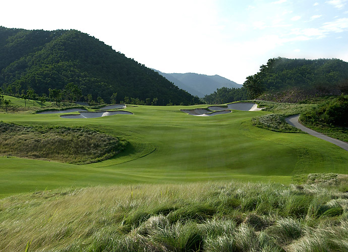7. Mission Hills Resort (Norman) in Shenzen, China: The original Mission Hills boasts the Guinness Book record for largest golf club in the world, with 12 courses scattered across three sites. The toughest and most dramatic course is the Norman. Amid jungle-like terrain that climbs and plunges in splendid, almost eerie isolation, the Norman serves up frighteningly deep bunkers and the hardest hole on the property, the 486-yard, par-4 12th, which plays uphill to a green backdropped by a dense grove of banana trees.