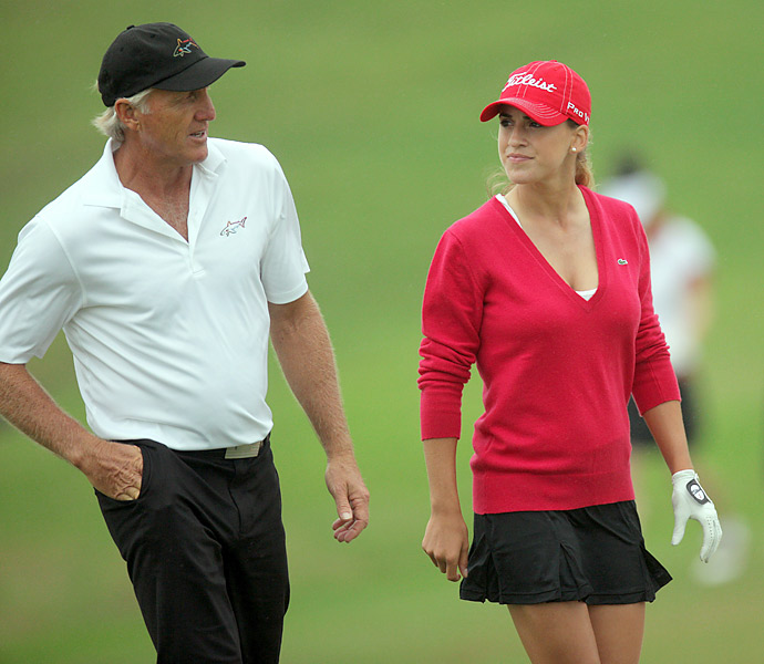 Golf legend Greg Norman and Mozo talk during a practice ahead of the inaugural Mission Hills Star Trophy on October 27, 2010 in Haikou, China. Mozo is sponsored by Norman's clothing company.