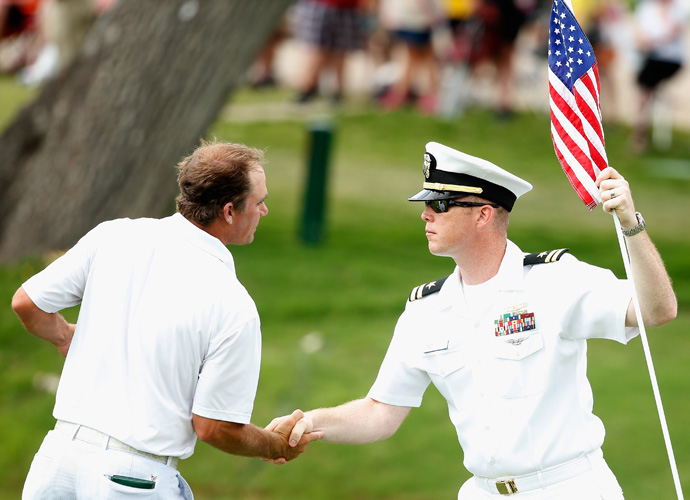 Nicholas Thompson shakes hands with a serviceman on the 18th hole. He shot a 4-under 66 on Sunday to tie for third at 8 under.