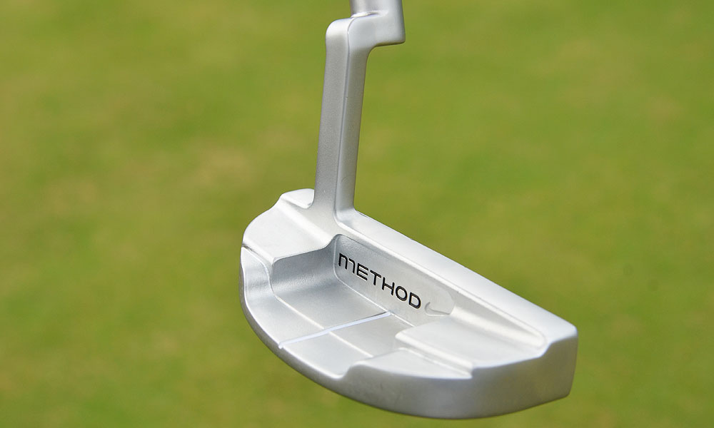 It has a plumber's neck hosel and more mass in the toe for golfers who have a slight arc in their putting strokes.