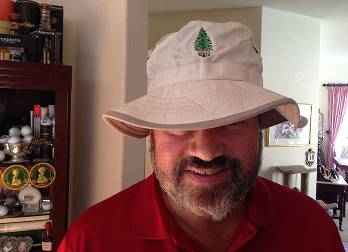 I donned a floppy sun hat from Pine Valley to battle the extreme heat of July 4th weekend, 2013. To commemorate the club's 100th anniversary, it reverted to its old logo for one year -- the pine tree, rather than the shield -- so I had me a collector's item, along with renewed appreciation for why PV remains No. 1.