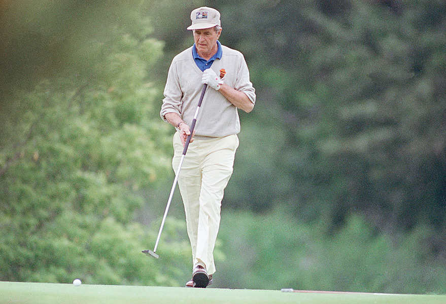 """Bush Sr. was not only a pretty good golfer, he was the fastest presidential golfer ever, maybe the fastest golfer ever. Just what the country needed to encourage faster play."" —Van Sickle. Photo: Bush uses a long putter during a round at Cape Arundel Golf Club in Kennebunkport, Maine, on July 1, 1989."
