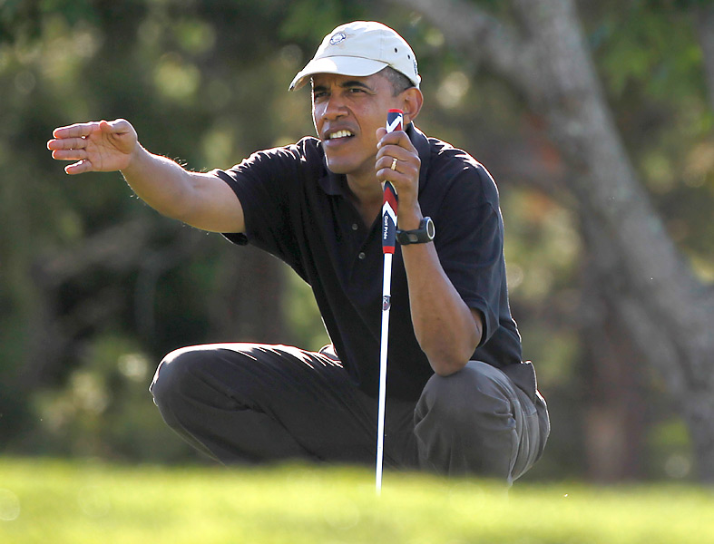 """I love that he plays, and that he had Rory McIlroy to the White House. He needs to be less bashful about his love of the game."" —Morfit. Photo: President Obama reads a putt at Farm Neck Golf Club, in Oak Bluffs, Mass., on Aug. 23, 2011."
